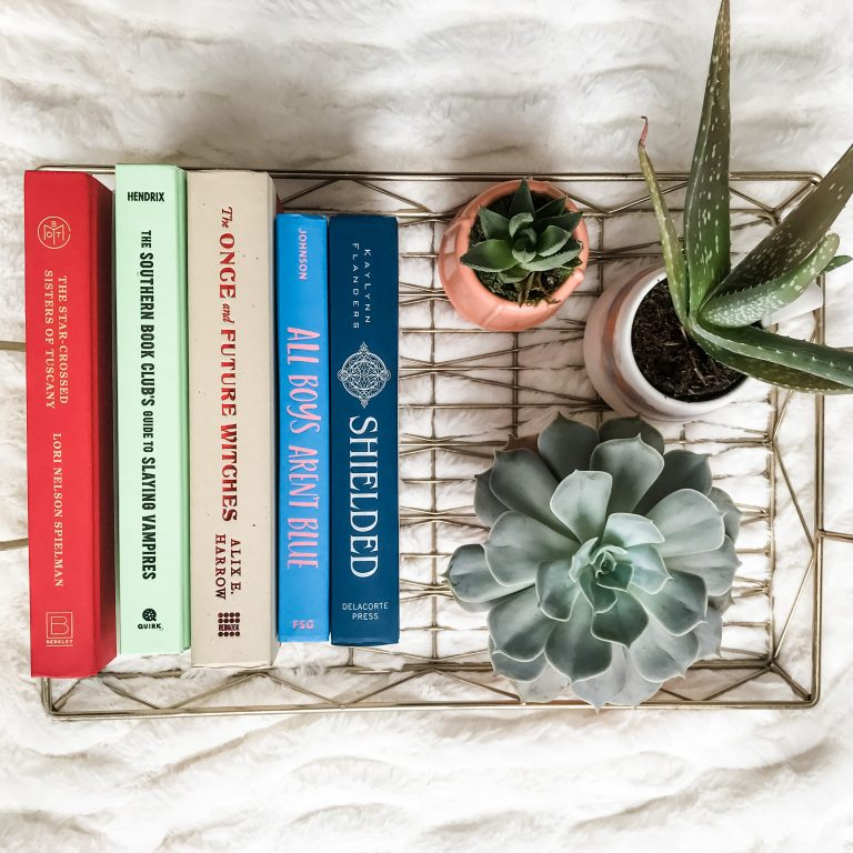 Books and plants on a tray